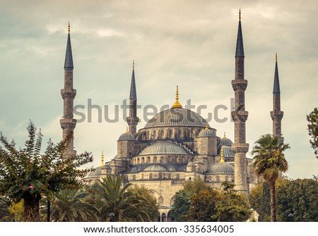 Blue mosque in Istanbul - famous landmark of islam architecture in Turkey. Four minarets of ancient mosque at cloudy sky, ottoman architecture style.
