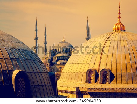 Blue Mosque with minarets - view from Hagia Sophia dome of Istanbul. Blue mosque in Istanbul in golden sunset light - famous landmark of islam architecture in Turkey.