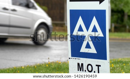 Blue MOT service sign on british road on cloudy rainy day. Photo stock ©