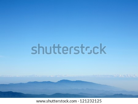 Blue mountain with blue sky and clouds background #121232125