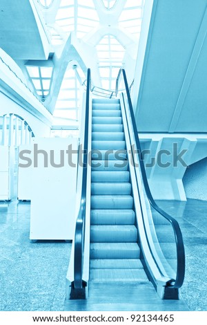 blue moving escalator inside shopping mall
