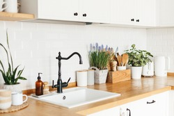 Blue muscari flower on white modern kitchen scandinavian style. Spring decoration eco friendly kitchen