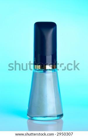 Blue Nail polish on blue background