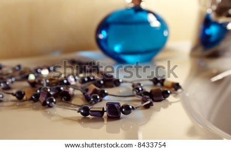 Blue necklace with stones and pearls - stock photo