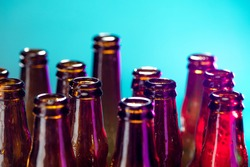 Blue. Neon colored beer bottles, close up isolated on bright studio background. Concept of beer, beverage, entertainment and alcohol. Copyspace for your bar, restaurant, brewery or shop advertising.