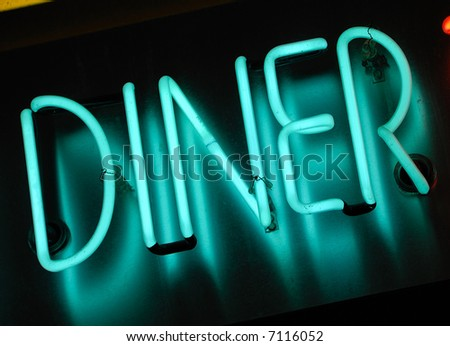 blue neon sign at night - diner