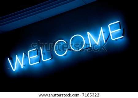 blue neon welcome sign