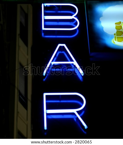 Blue neon wine bar sign at night in summer, with copy space.