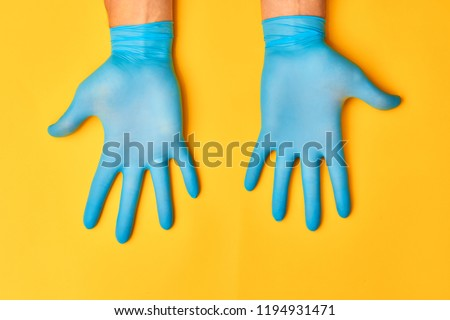 Blue Nitrile gloves. Hands of a medic in the blue latex gloves
