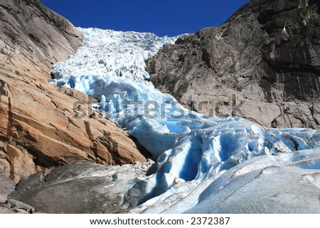 Blue norwegian glacier Briksdale in detail - stock photo