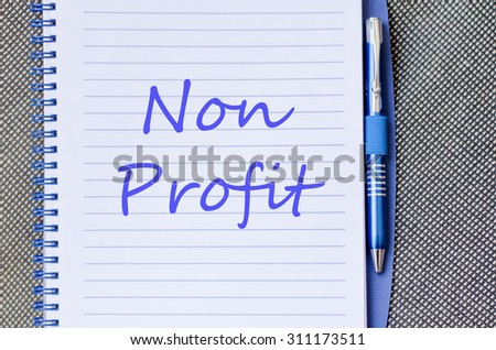 Blue notepad and Non profit text concept