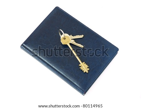 Blue notepad with keys isolated on white