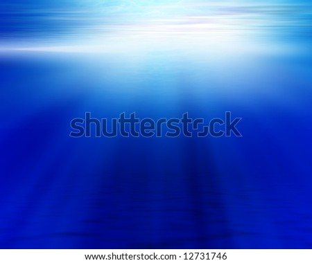blue ocean floor and surface with light shining through the surface