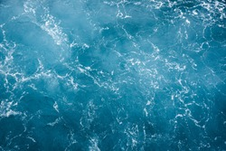 Blue ocean water texture background. Surface of the sea.