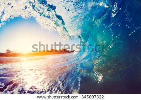 Blue Ocean Wave Crashing at Sunrise #345007322