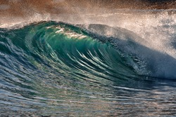 Blue Ocean Wave Getting Barreled at Sunset. Perfect wave for surfing