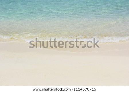 Blue ocean wave on sandy beach #1114570715