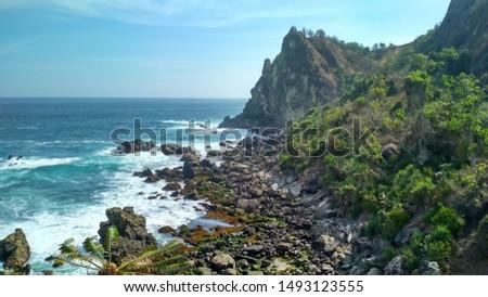 Blue Ocean Wave With Mountain View at GunungKidul Yogyakarta Indonesia