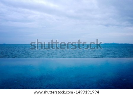 blue ocean with cloudy sky, Gloomy sky clover above the blue sea #1499191994