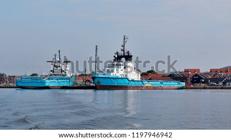 Blue offshore vessels in port at Faaborg, Denmark #1197946942