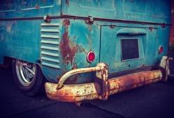Blue old van - Back part of a blue old rusty van.