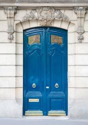 Blue old wooden door in Paris, France