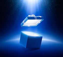 Blue open gift box on glittering background