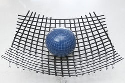 Blue orb sitting on wire mesh looking like earth distorting spacetime to produce gravity