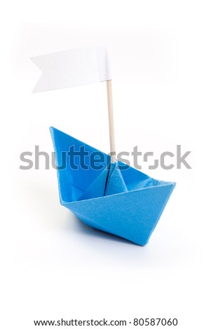 blue origami boat with white flag