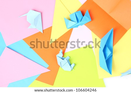 blue origami on bright paper background