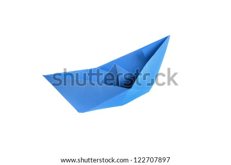 Blue origami paper boat isolated on white