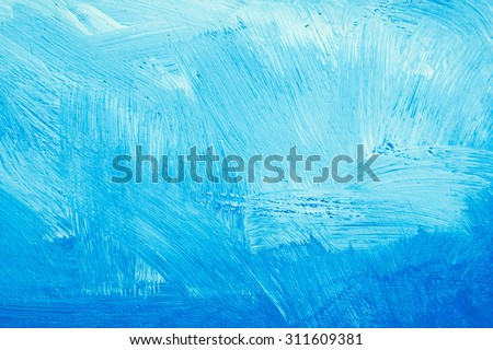 blue paint on a stone surface ...