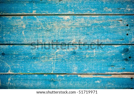 blue paint on old wooden fence