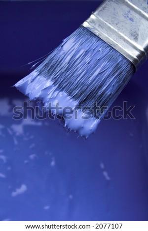 blue paint on paintbrush
