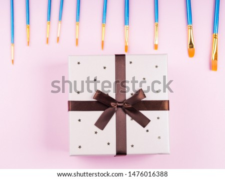 Blue paintbrushes on pink background. Art supply concept #1476016388