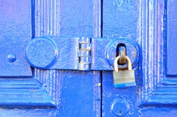 Blue Painted Door with Close Up of Padlock & Hasp