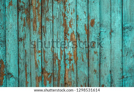 Blue painted plank fence with cracked and scratch. Horizontal grunge texture #1298531614