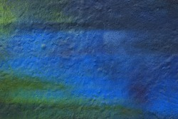 Blue painted wall texture for designer background. Spray paint. Raster image.