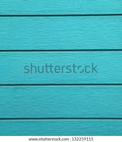 Blue painted wood wall as background.