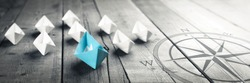 Blue Paper Boat Leading A Fleet Of Small White Boats With Compass Icon On Wooden Table With Vintage Effect - Leadership Concept