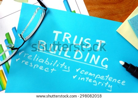 Blue paper with words trust building and glasses.  - Shutterstock ID 298082018