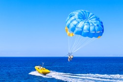 Blue parasail wing pulled by a boat. Sea summer recreation  - Cyprus.