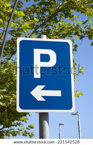 Blue Parking Sign in Urban Setting