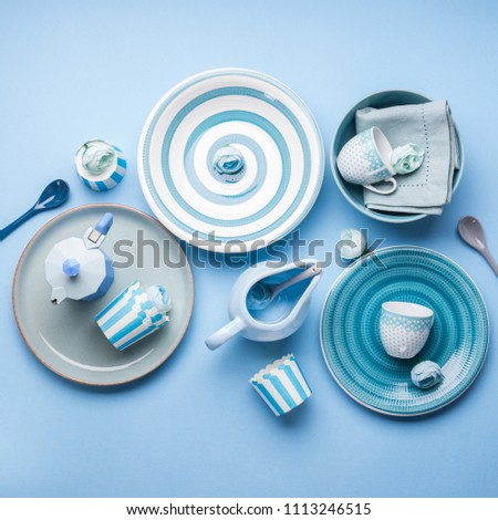 Blue pastel ceramic tableware crockery set on abstract background #1113246515