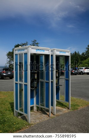 Blue pay phone booths in a parking lot on the Olympic Peninsula, Washington, USA. #755898595