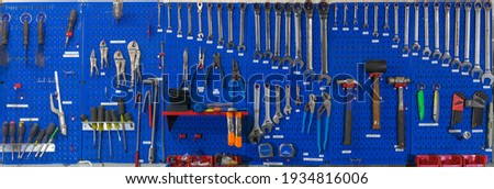Blue Pegboard Tools Wall with variety tools  Stock photo ©