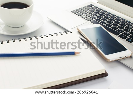 Blue pencil with Book and cup of coffee on white background