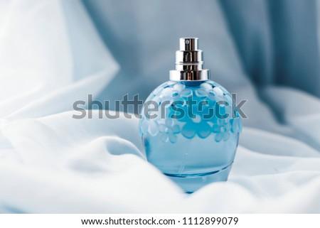 blue perfume on light background #1112899079