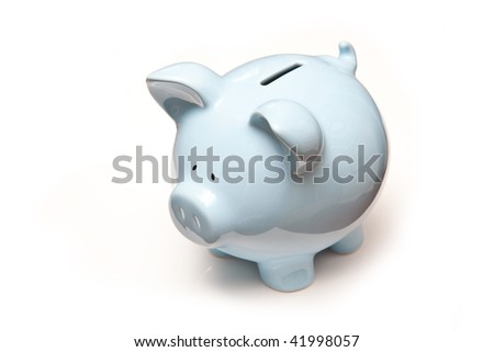 Blue piggy bank money box isolated on a white studio background.