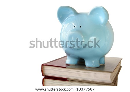 Blue piggy bank on stack of text books.  Saving for a college education.